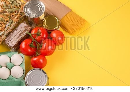 Food Donations On Yellow Background With Copyspace - Pasta, Fresh Organic Vegatables, Canned Food, E