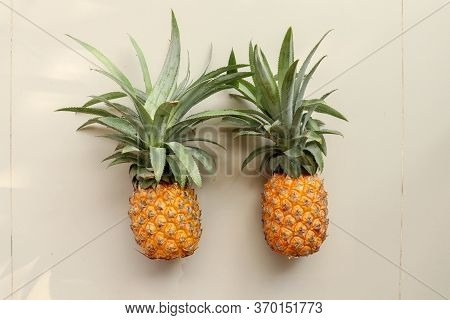 Couple Whole Pineapple Tropical Fruit Or Ananas Isolated On White Background. Whole Ananas With Leav