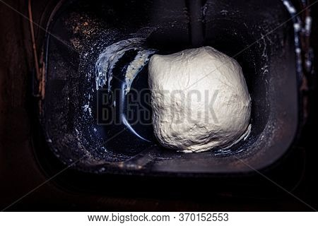 Freshly Prepared Dough In Bread Pan Of Breadmaker For Home Use. Not Raised Dough Preparing For Bakin