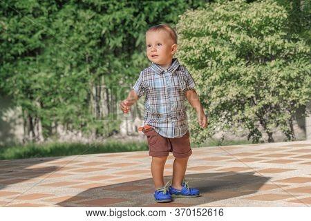 Little boy walks on the street