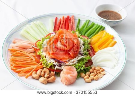 Chinese New Year Auspicious Food (yu Sheng) Eating On Celebrations Ingredients With Peanut, Salmon,