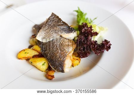 sea bass fish grilled with potato