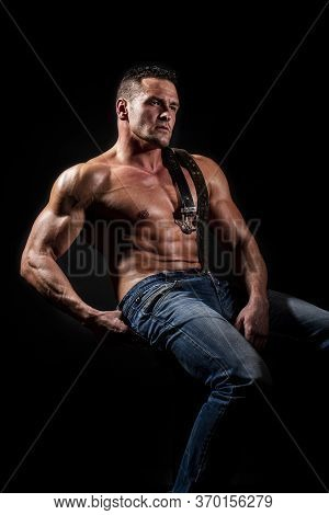 Strong Athletic Man Showing Muscular Body, Sixpack Abs. Torso With Six Packs Looks Attractive On Bla