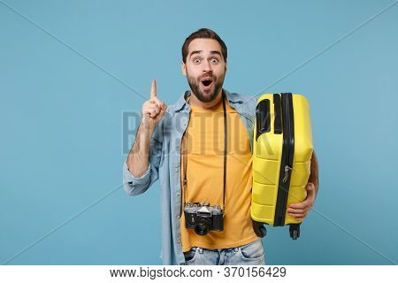 Traveler Tourist Man In Summer Clothes With Photo Camera Isolated On Blue Background. Male Passenger
