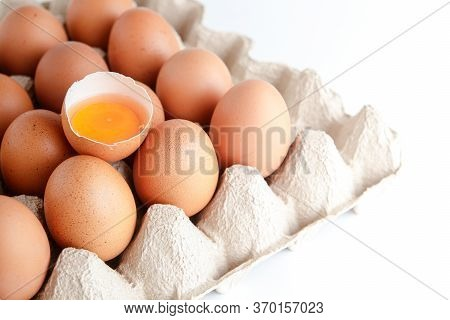 Many Organic Eggs Are Placed In The Paper Tray And There Are Egg Yolks In The Middle. Is A Food That