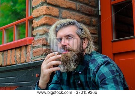 Stylish Hipster With Cigarette. Sensual Man Smoking Outside. Tobacco. Smoking Hipster. Sensual Beard