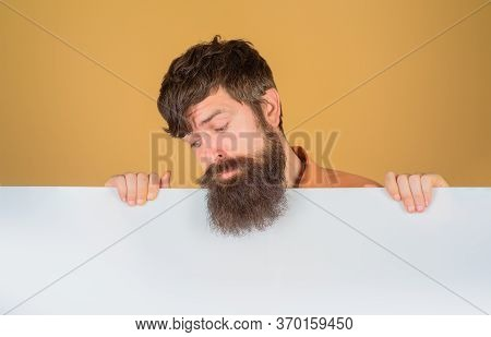 Advertising Board. Copy Space. Bearded Man Looking On Blank Board. Space For Text. Man Holds Empty B