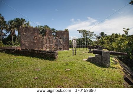 Old Brick Fortress Walls Of Fort Zeelandia In The Subtropics Against A Background Of Green Trees And