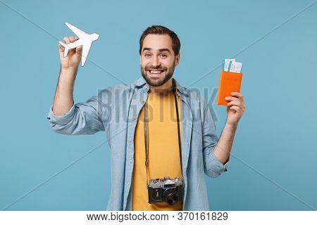 Smiling Traveler Tourist Man In Casual Clothes With Photo Camera Isolated On Blue Background. Passen