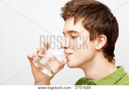 Young Man Is Drinking Mineral Water