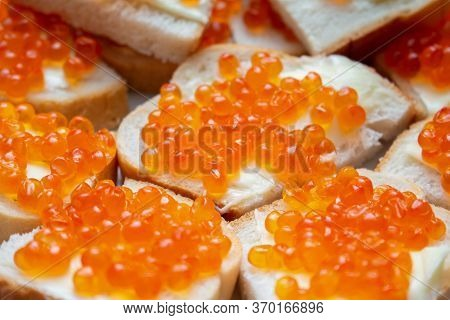 Sandwiches With Red Caviar And Butter Close Up
