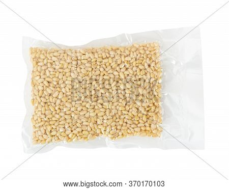 Pine Nuts In Transparent Vacuum Packaging Isolated On White Background.