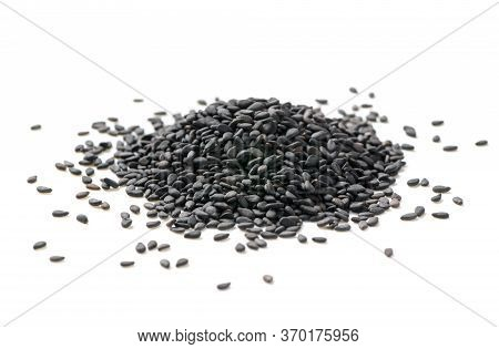 Black Sesame Seeds Isolated On White Background. The Benefits Of Black Sesame Help To Strengthen Hai