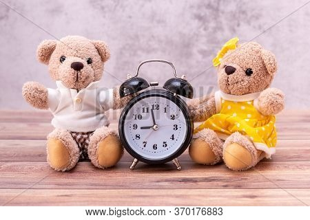 Couple Teddy Bear And Clock On Table Wooden. Valentine's Day Celebration