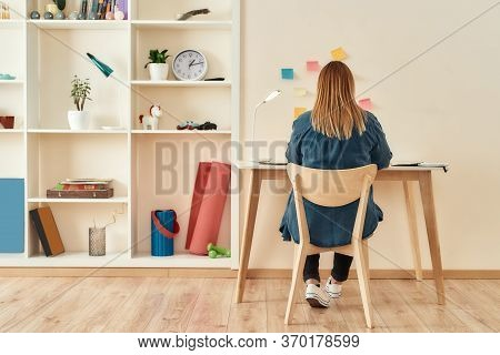 Creative Workplace. Young Woman In Casual Clothes Sitting At Office Desk, Working Or Studying At Hom