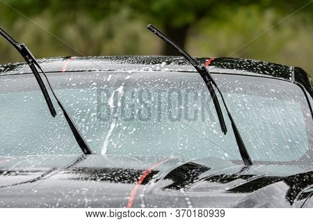 Washing Car With Foam In The Summer