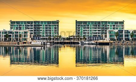 Port Adelaide, South Australia - July 13, 2014: Wirra Drive Apartment Buildings Reflecting In The Ri