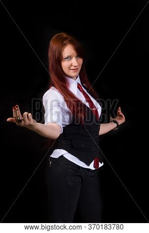 A Defiant, Strict, Discontented Red-haired Girl Shows A Discontented Gesture, Dressed As An Office W