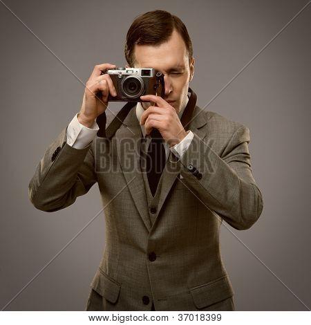 Businessman with a retro camera