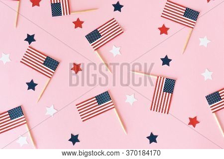 Many Little American Flags And Stars On Pink Background, Flat Lay. 4th Of July, Happy Usa Independen