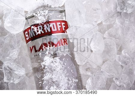 Bottle Of Smirnoff Red Label Vodka In Crushed Ice