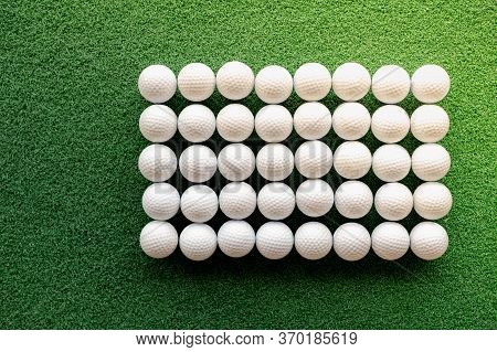 The White Golf Ball Put On The Grass Course Preparing To Golf Player Hit The Golf  Ball.