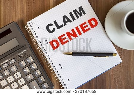 Notepad With Text Claim Denied On Wooden Table Near Calculator And Coffee