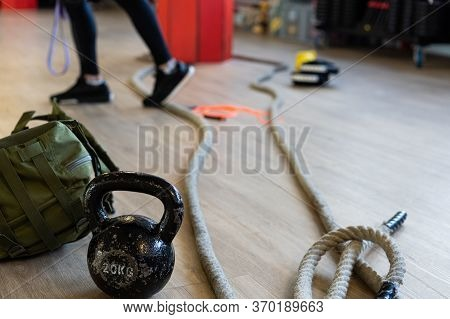Gym Equipment For Boot Camp And Work Out With Kettle Bell, Rope, Sandbag In Gym Hall On The Floor. I