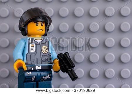 Tambov, Russian Federation - June 04, 2020 Portrait Of Lego Policeman Minifigure With Gun Against Gr