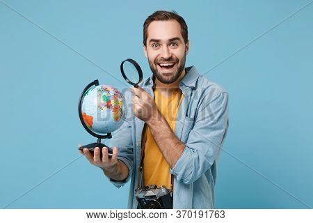Excited Traveler Tourist Man In Yellow Clothes With Photo Camera Isolated On Blue Background. Passen