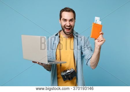 Traveler Tourist Man In Summer Clothes With Photo Camera Isolated On Blue Background. Passenger Trav