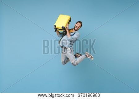 Crazy Traveler Tourist Man In Yellow Casual Summer Clothes Isolated On Blue Background. Male Passeng