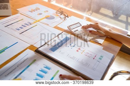 Bookkeeper Or Businesswoman Using A Calculator To Calculate Report Profit, Analyzer Graph Balance, T