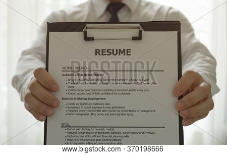 The Unemployed Are Presenting Their Resume To Prepare For A Job Interview. New Job Interview Concept