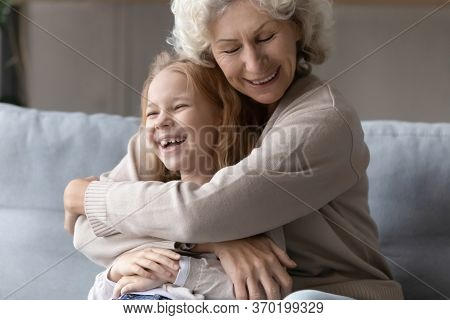 Overjoyed Grandmother Embrace Playing With Little Granddaughter
