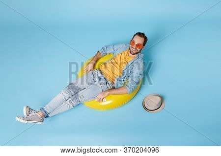 Smiling Traveler Tourist Man In Casual Summer Yellow Clothes Eyeglasses Isolated On Blue Background.