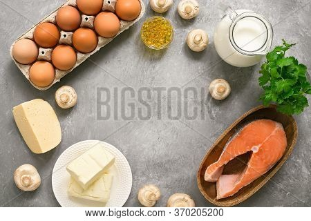 A Food Frame Rich In Vitamin D. Products High In Vitamin D On A Gray Concrete Background. Top View,