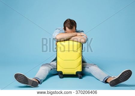 Tired Traveler Tourist Man In Summer Casual Clothes Isolated On Blue Wall Background. Male Passenger