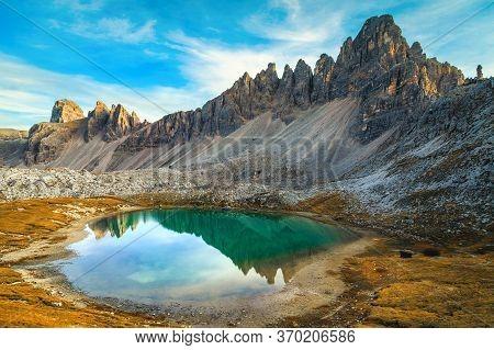 Majestic Alpine Landscape With Turquoise Mountain Lake Lago Dei Piani. Paterno Mountain Ridge Reflec
