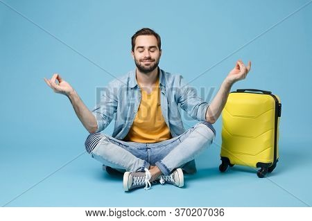 Traveler Tourist Man In Summer Clothes Isolated On Blue Background. Male Passenger Traveling Abroad
