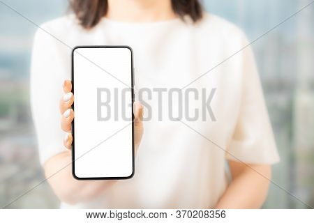 Woman In White Dress Showing Blank Screen Mobile Phone Women Hand Show The Mobile Phone At The White