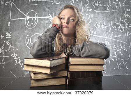 Thinking girl. Background blackboard with maths