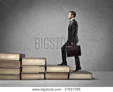 Businessman with suitcase walking the scale