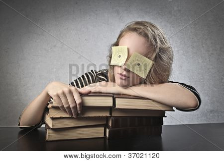 Masked girl with books