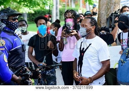 Miami Downtown, Fl, Usa - May 31, 2020: Miami-area Police And Protesters.the Protests Have Spread To