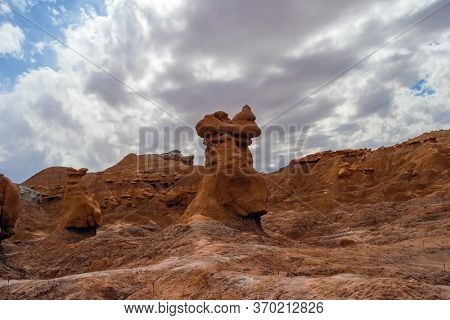 USA. Hoodoo - geological formations. Funny red-brown sandstone remnants formed by erosion. Picturesque Utah state park Goblin Valley. The concept of active, ecological and photo tourism