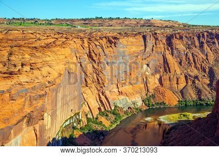 The Colorado River is swift USA river. Best journey in life. Glen Canyon Dam across the Colorado River. Concept of active, ecological and photo toursm