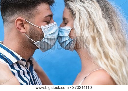Young Couple Kissing While Wearing Face Surgical Mask During Corona Virus Outbreak - Man And Woman W