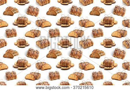 Seamless Pattern From A Rusks Of Crackers On A White Background. The Concept For Culinary Design.