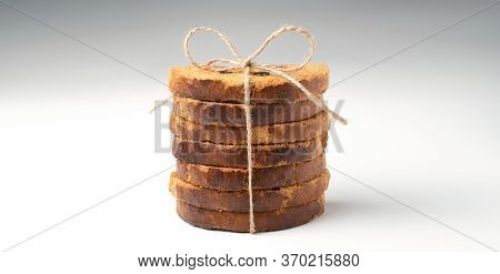 Sweet Rusks With Raisins Sprinkled With Sugar On A White Background. Concept For Your Design.